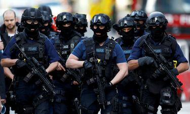 Armed police visiting premises that refuse to close in Liverpool in October 2020.jpg